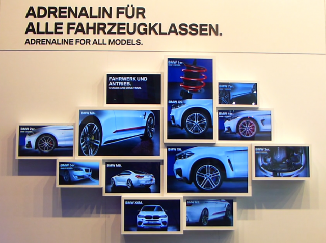 A photo of the exhibit's 12 screens, showing different views of a car