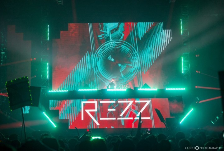 Rezz logo projected on a surface at a concert