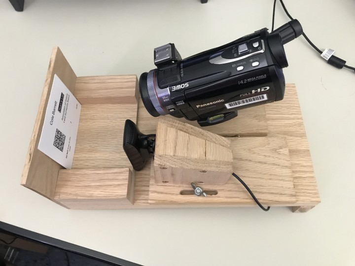 Video camera mounted on wood frame and pointed at barcode