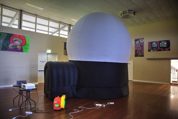The rear of the dome and the fan that inflates it.