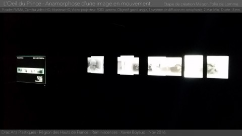 Photo of the screens and projectors in the L'Oeil du Prince installation with room lights off